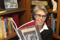 Scarsdale librarian Eileen Corbett holding book