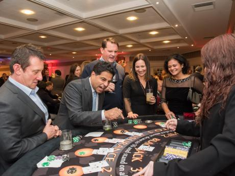 Casino Night 2019 guests playing cards